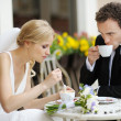 Bride and groom at outdoor cafe — Stock Photo