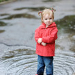 Adorable toddler girl at rainy day in autumn — Stock Photo #13727651