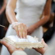 Bride taking a ring from a pillow - Foto de Stock