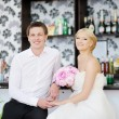 Stock Photo: Bride and groom at beach cafe
