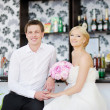 Bride and groom at beach cafe — Stock Photo #13727770