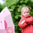 Adorable toddler girl at rainy day in autumn — Stock Photo #13727771