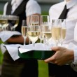 Waitress with dish of champagne glasses — Stock Photo #13727794
