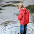 Adorable toddler girl at rainy day in autumn — Stock Photo #13727884
