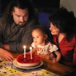 Family celebrating daughter's second birthday - Stock Photo