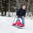 Winter fun: having a ride on a snow shovel — Stock Photo #13727988