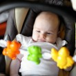 Little baby playing in a carseat — Stock Photo