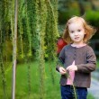 Adorable little girl portrait outdoors — Stock Photo #13728045