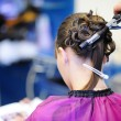 Woman's stylist's hands making a hairstyle — Stock Photo #13728103