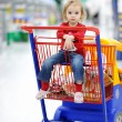 Adorable toddler sitting in shopping cart — Stock Photo