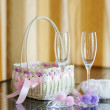 A pair of wedding glasses, basket and a ring pillow — Stock Photo