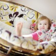 Little girl in pajamas on sunny morning — Stock Photo #13728248