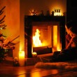 Stock Photo: Young mother and daughter by fireplace