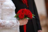 Bride holding white wedding flowers bouquet — Stock Photo