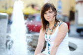Young attractive woman by a fountain — Fotografia Stock