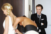 Groom watching his bride getting ready — Stock Photo