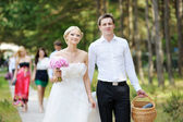 Bride and groom having a walk — Stock Photo