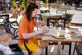 Young father and his toddler girl having a meal — Stock Photo