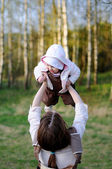 Young mother holding her baby girl — Stock Photo