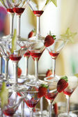 Deliciuos red coctail tower with strawberries — Stock Photo