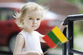 Adorable toddler girl with lithuanian flag — Stock Photo