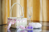 A pair of wedding glasses, basket and a ring pillow — Stok fotoğraf