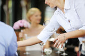 The waiter with a wine glass — Stock Photo