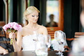 Bride drinking champagne — Stock Photo