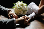Bride and groom holding their hands — Stock Photo