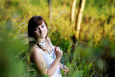 Young beautiful woman at a sunset — ストック写真