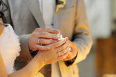 Bride and groom litting a candle — Stock Photo