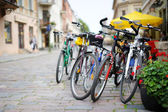 Row of parked colorful bikes — Стоковое фото