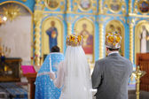 Bride and groom in an orthodox church — Стоковое фото