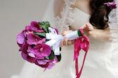 Bride holding beautiful bridal bouquet — Stock Photo