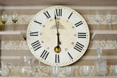 Clock closeup in decorated living room — Stock Photo