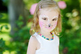 Adorable little girl with her face painted — Stok fotoğraf