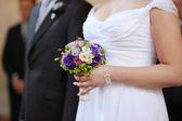 Bride holding blue flowers — Stock Photo