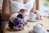 Bride drinking coffee — Stock Photo