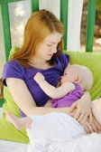 Mother breastfeeding her baby — Stock Photo