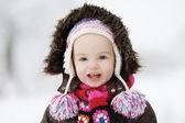 Little winter baby girl smiling — Stock Photo