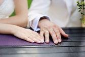 Bride's and groom's hands — Stock Photo