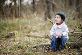 Adorable girl on early spring or autumn — Stock Photo