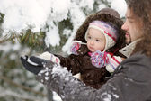 Little winter baby girl and her father — Stock Photo