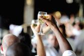 Men's hand holding wine glass — Stock Photo