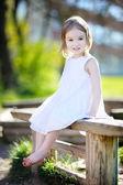 Adorable preschooler girl portrait outdoors — Stock Photo