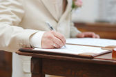 Groom signing wedding contract — Stock Photo