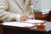 Groom signing marriage license — Stock Photo
