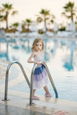 Portrait of cute little girl at the pool — Stock Photo