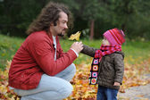 Father and his baby girl in an autumn park — Stock Photo