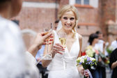 Bride holding champagne glass — Stock Photo